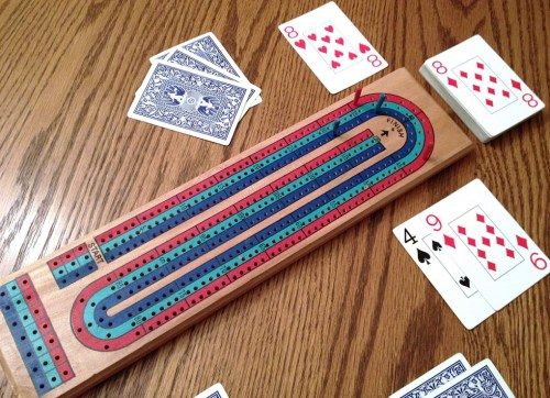 Single-track 3-lane cribbage board - the board is used only for keeping score - as opposed to a pad and pen, like most traditional card games.