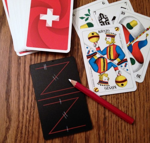 "The best partnership games are of the ""marriage group,"" so-called because pairing Kings-Queens of the same suit score points (Pinochle is the most common American version). Here a Jass board is used to keep score in Jass - the national card game of Switzerland, but with dozens of variations throughout the world."
