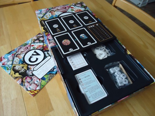 The overly large box, with board and rulebook also displayed.