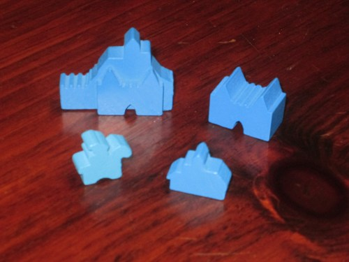 The different player pieces in Barony. There are knights, villages, strongholds, and cities, and there never seem to be enough of them, so players have to be judicious in placing them.