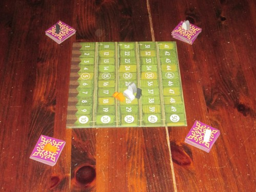Between Two Cities set up for four players.