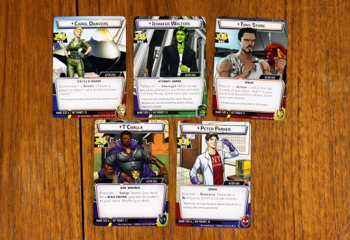 Five alter-ego cards: Carol Danvers, Jessica Walters, Tony Stark, T'Challa, Peter Parker