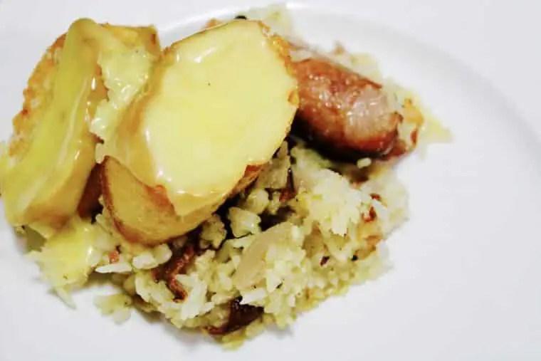 Sausage, bacon & chicken rice bake with cheesy garlic bread