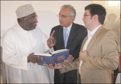 Dr Nader El-Bizri and Professor Azim Nanji explaining to Professor Rashid some of the refe- rences in the book