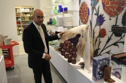 Shoheb Gwaduri extends Kyrgyz scarf to expose the beautiful design inspired by one of AKM's Masterpieces.