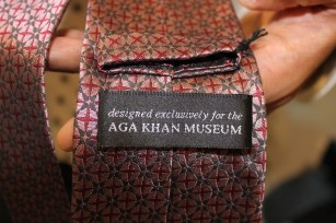 """Tie label """"designed exclusively for Aga Khan Museum."""""""