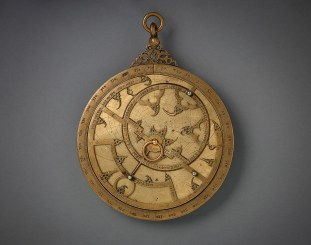 Planispheric Astrolabe, from the Iberian peninsula, 14th c., bronze inlaid with silver, 5 1/3 inches diameter; courtesy of Aga Khan Museum, Toronto.