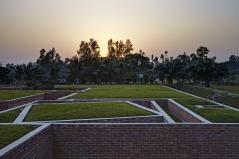 Top view at dusk. Aga Khan Award for Architecture 2016 Winner: Friendship Centre Gaibandha, Bangladesh