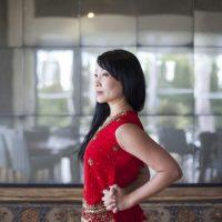 YuMee Chung demonstrates the 'Elbow Room' yoga stretch at Aga Khan Museum's Diwan Restaurant