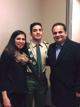 Rafi with his parents.