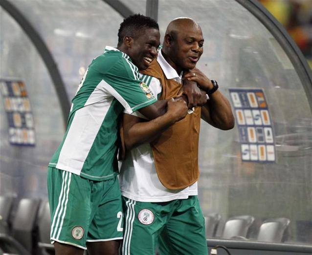 Keneth Omeruo hugs Keshi after he led Nigeria to the Nations Cup