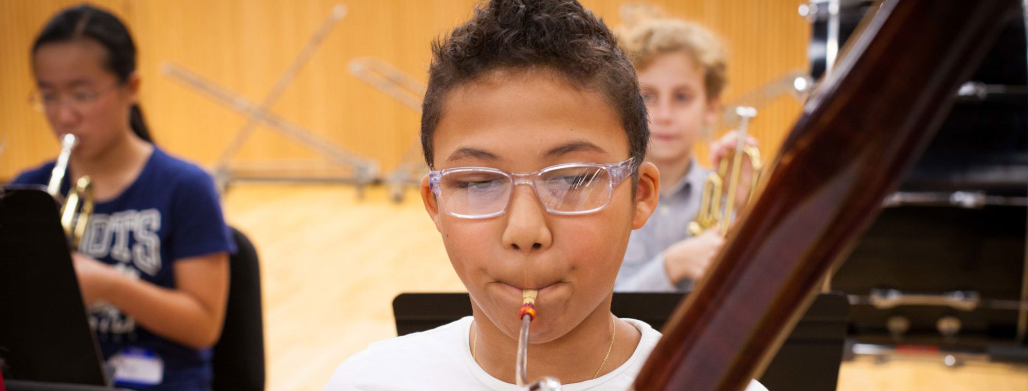 Boy with Glasses Playing Instrument