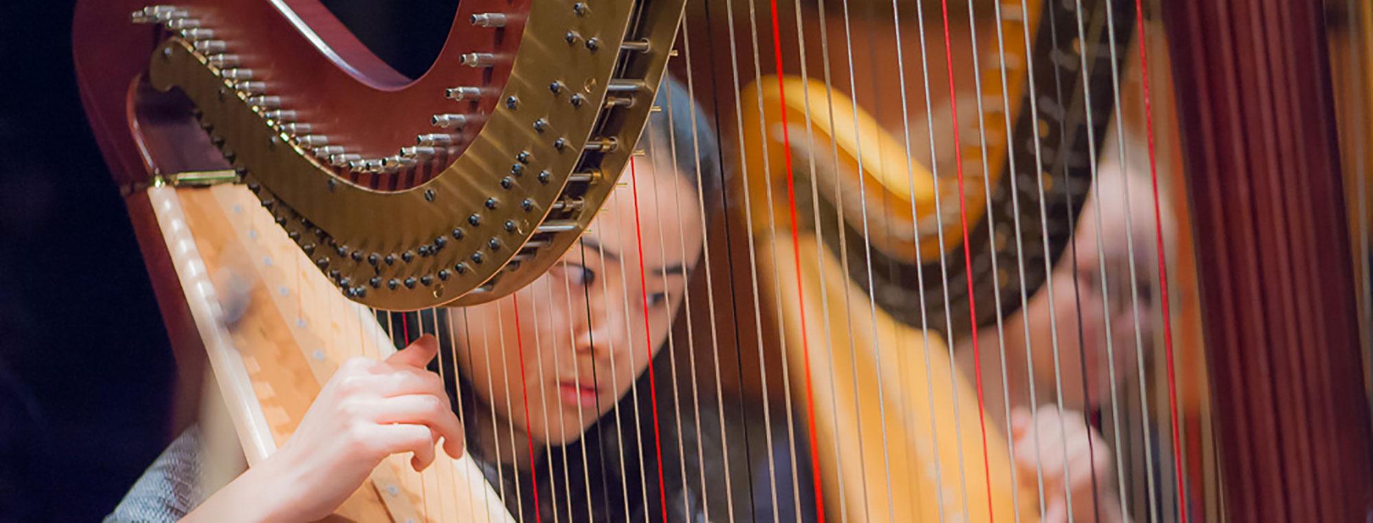 Young Girl Playing Harp