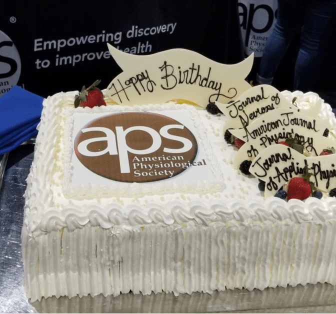 Birthday cake celebrating milestone anniversaries for APS journals.