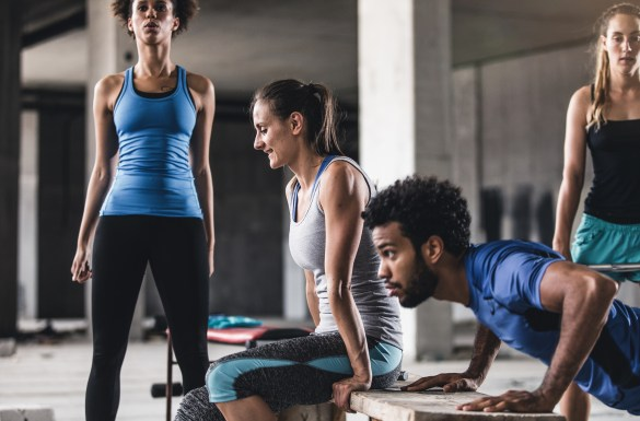Group of Young People Exercising in a Gym