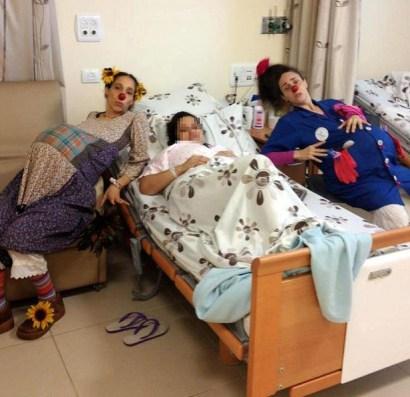 """Shirley Goldstein (""""Florina"""") and Ayelet Shadmon (""""Yula"""") with a laboring mother at Poriya Hospital."""