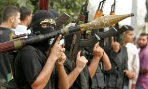 Islamic Jihad militants attend the funeral of al-Basyoni in the northern Gaza strip
