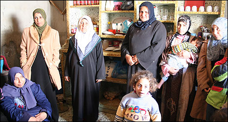 Insharar al-Atar (second left) says she forgives her husband for his aggression because she knows what he is going through