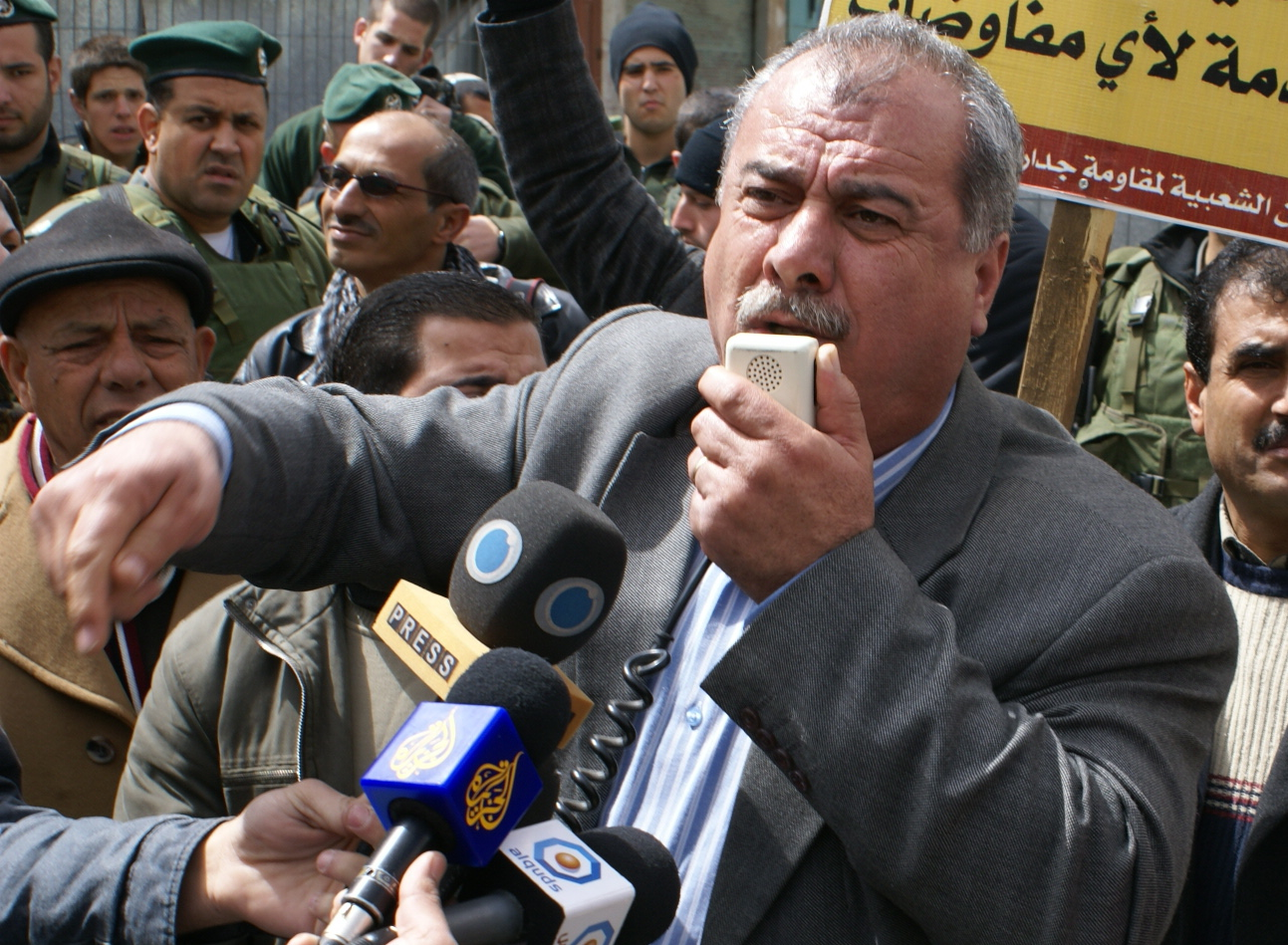 MK Mohammad Barakeh addresses protesters in front of the entrance to Shuhada Street in Hebron