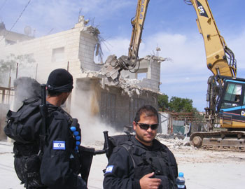 Demolition of the Dwiyat family's house, East Jerusalem. Photo: Kareem Jubran, B'Tselem, 7 April 2009.