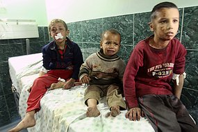 Palestinian boys wounded by an Israeli tank shell wait for treatment at Shifa hospital in Gaza in January