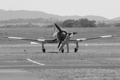 This image just seems right in monotone. You don't see planes being started this way very often these days.