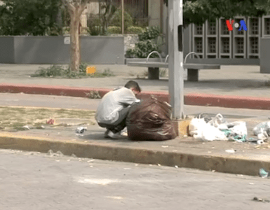 Venezuelans eating garbage