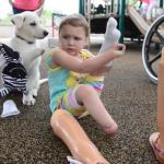 Little Girl without Feet Gets Puppy Missing a Paw