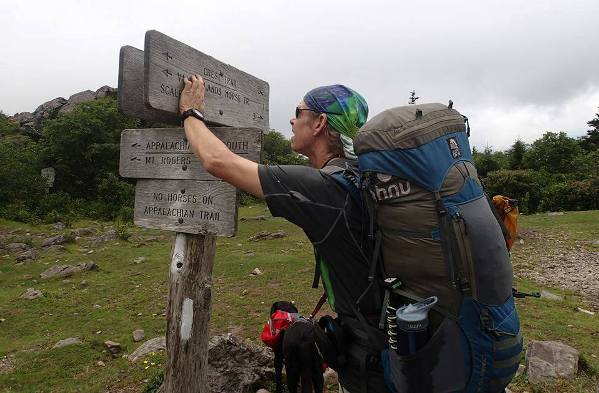 blind hiker Trevor Thomas and guide dog Tennille trail marker