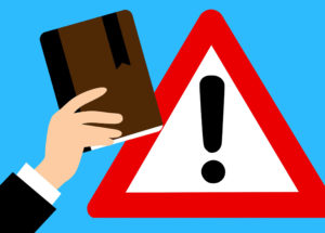 Zu sehen ist eine Grafik von einer Hand, die ein IT-Notfallhandbuch hält, im Hintergrund ist in Warndreieck. Bild: Pixabay / Clker-Free-Vector-Images & Mohamed Hassan / Montage IT-SERVICE.NETWORK