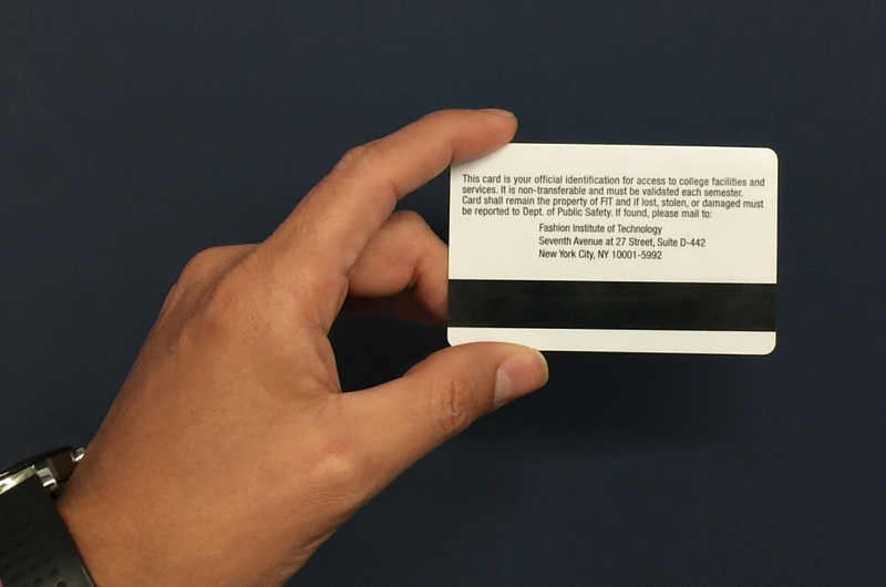 Man Holding FIT ID Card with Back instructions displayed