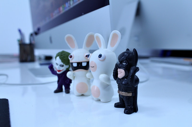 Desk with Mac and Rabbit, Joker and Batman Toys