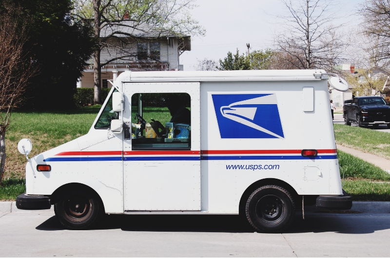 USPS Truck Parked in Front of a Home