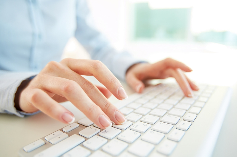Close up of Woman Typing