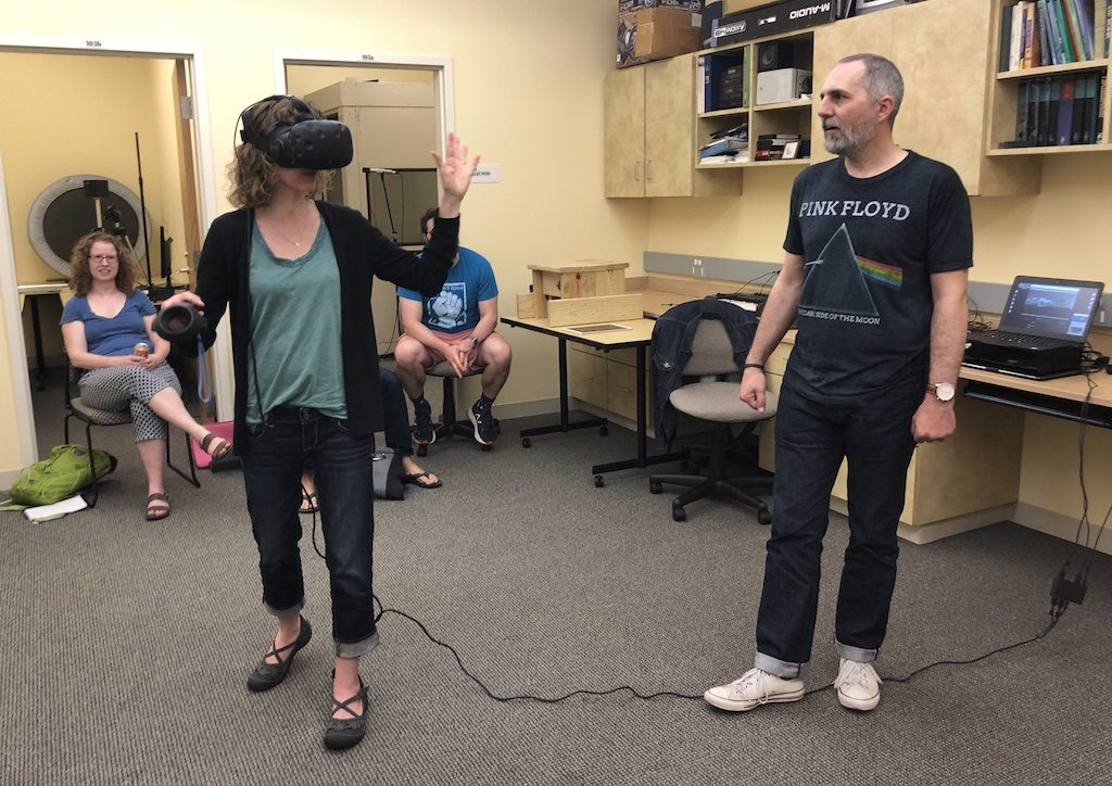 A woman in an HTC Vive VR headset