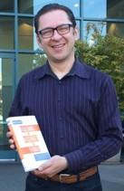 _Maciej with book-2_1