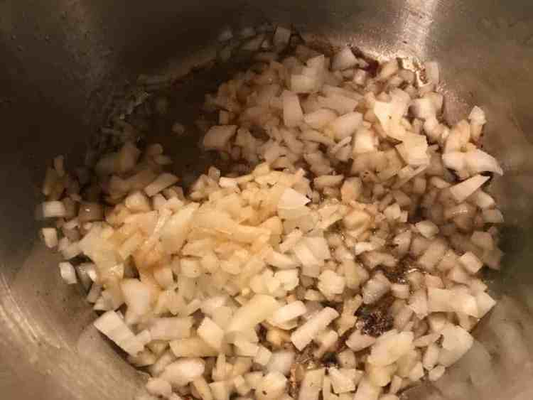 Onions added to pot of butter and bacon fat