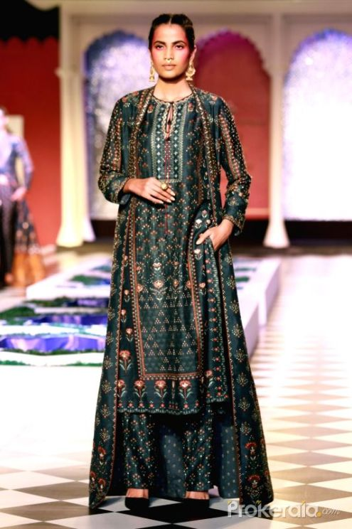 a-model-walks-the-ramp-displaying-an-outfit-by-438290