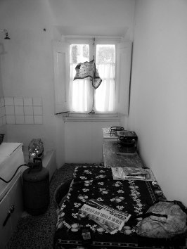 Kitchen with gas tank and shower at left
