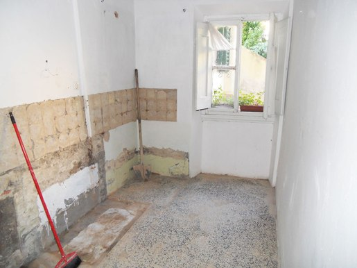 Kitchen with counter/oven/sink/shower stall removed