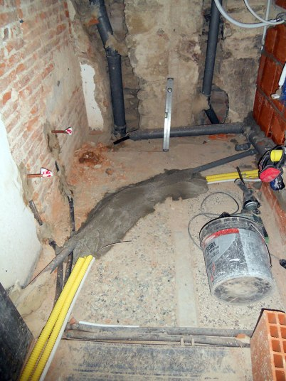 Bathroom tubing to be under raised flooring