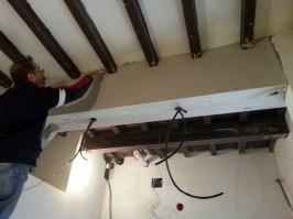 Drywall encasing new steel beam