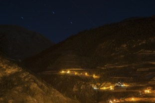 houses on the high mountain with stars background