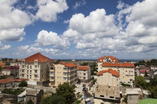 Pretty view of roofs in a new district and clouds
