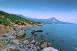 Rocky beach at dusk. Bay of Laspi, Crimea. Ukraine