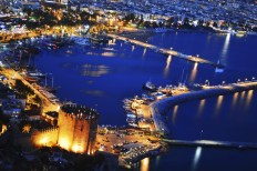 View of harbor form Alanya peninsula. Turkish Riviera by night