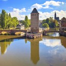 Strasbourg, medieval bridge Ponts Couverts and Cathedral. Alsace