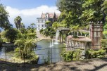 Tropical garden with pond and palace at Madeira, Portugal