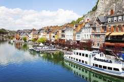 City view of Dinant on Meuse river with ships