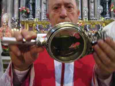 Examining the ampoule of San Gennaro's blood